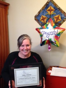 Amy with her certification!